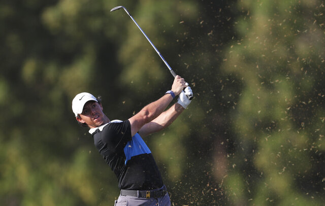 Rory McIlroy of Northern Ireland plays a shot on the 16th hole during the third round of the DP World Tour Championship golf tournament in Dubai, United Arab Emirates, Saturday, Nov. 23, 2019. (AP Photo/Kamran Jebreili)