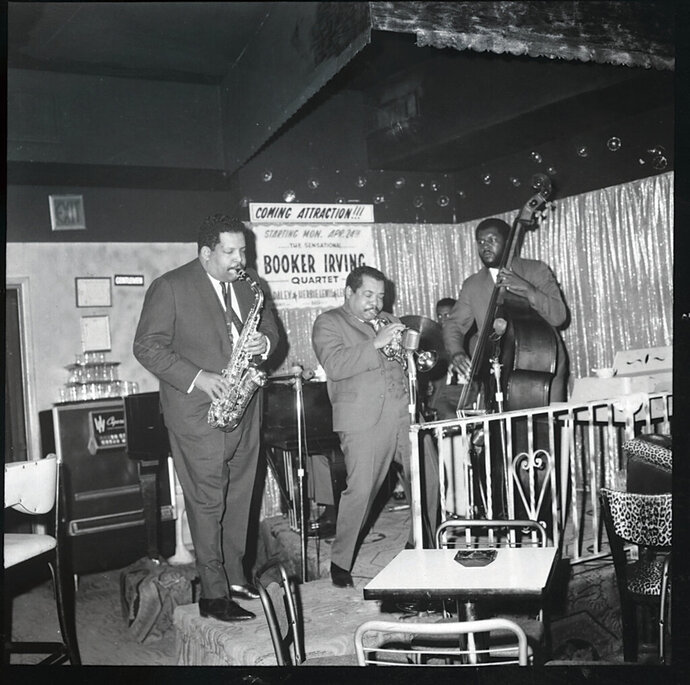 In this 1966 photo, Cannonball Adderley, left, performs with his brother Nat Adderley on cornet and Victor Gaskin on bass Seattle's Penthouse jazz club.. On Friday, a small jazz label is set to digitally release a rare recording by jazz legend Cannonball Adderley from 1966 concerts in Seattle. (Devra Hall via AP)