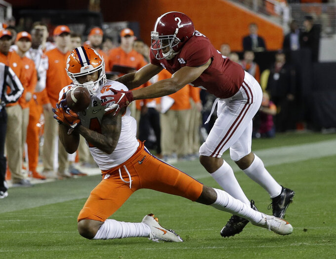 Clemson's Diondre Overton catches a pass in front of Alabama's Patrick Surtain II during the second half of the NCAA college football playoff championship game Monday, Jan. 7, 2019, in Santa Clara, Calif. (AP Photo/David J. Phillip)