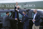 President Joe Biden waves as he gets into a motorcade vehicle after stepping off Marine One at Delaware Air National Guard Base in New Castle, Del., Friday, April 16, 2021. Biden is spending the weekend at his home in Delaware. (AP Photo/Patrick Semansky)