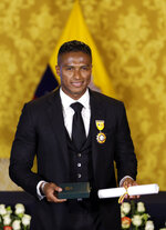 Soccer star Antonio Valencia poses for a photo after a ceremony in which the fullback was decorated with a National Order of Merit, in Quito, Ecuador, Tuesday, May 14, 2019. The Ecuadorian's final game with Manchester United was Sunday, after 10 seasons with the team. (AP Photo/Dolores Ochoa)