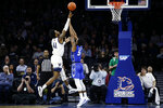 Villanova's Saddiq Bey, left, goes up fro a shot against Creighton's Ty-Shon Alexander during the second half of an NCAA college basketball game, Saturday, Feb. 1, 2020, in Philadelphia. (AP Photo/Matt Slocum)