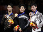 From left, Japan's Yuzuru Hanyu, Nathan Chen from the U.S. and Vincent Zhou from the U.S. display their silver, gold and bronze medals respectively during the men's free skating routine during the ISU World Figure Skating Championships at Saitama Super Arena in Saitama, north of Tokyo, Saturday, March 23, 2019. (AP Photo/Andy Wong)