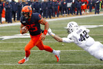 Illinois running back Dre Brown (25) runs past Northwestern linebacker Paddy Fisher (42) for a touchdown during the first half of an NCAA college football game Saturday, Nov. 30, 2019, in Champaign, Ill. (AP Photo/Charles Rex Arbogast)
