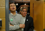 South Bend Mayor Pete Buttigieg, left, waits to speak to the crowd about his Presidential run during the Democratic monthly breakfast held at the Circle of Friends Community Center in Greenville, S.C. Saturday, March 23, 2019. Paul Merlo, right, GCDP volunteer coordinator, waits to escort Mayor Pete into the hall. (AP Photo/Richard Shiro)