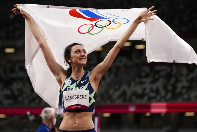 Mariya Lasitskene, of Russian Olympic Committee, reacts after winning the women's high jump final at the 2020 Summer Olympics, Saturday, Aug. 7, 2021, in Tokyo.(AP Photo/Charlie Riedel)