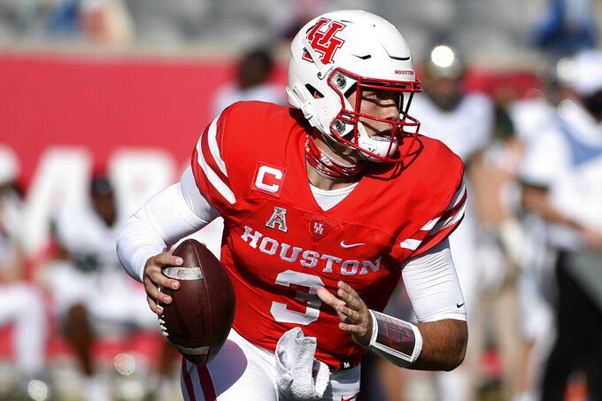 Houston quarterback Clayton Tune scrambles during the first half of an NCAA college football game against South Florida, Saturday, Nov. 14, 2020, in Houston. (AP Photo/Eric Christian Smith)
