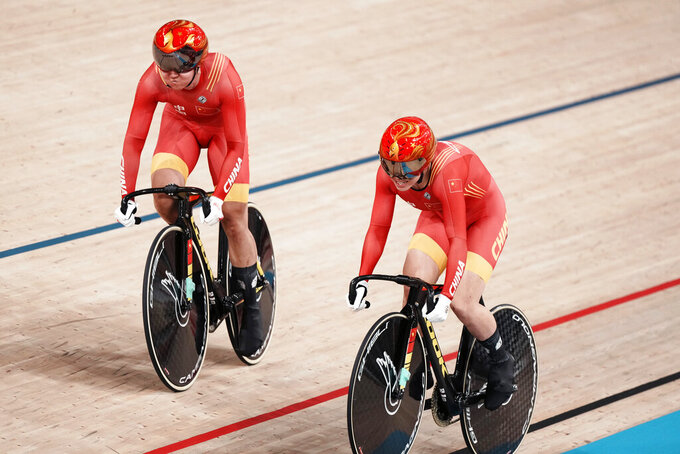 Tianshi Zhong, left, and Shanju Bao of Team China compete during a qualifying heat for track cycling women's team sprint at the 2020 Summer Olympics, Monday, Aug. 2, 2021, in Izu, Japan. (AP Photo/Thibault Camus)