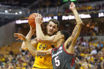 Missouri's Reed Nikko, left, pulls down a rebound over Arkansas' Jalen Harris, right, during the second half of an NCAA college basketball game Saturday, Feb. 8, 2020, in Columbia, Mo. Missouri beat Arkansas 83-79 in overtime. (AP Photo/L.G. Patterson)