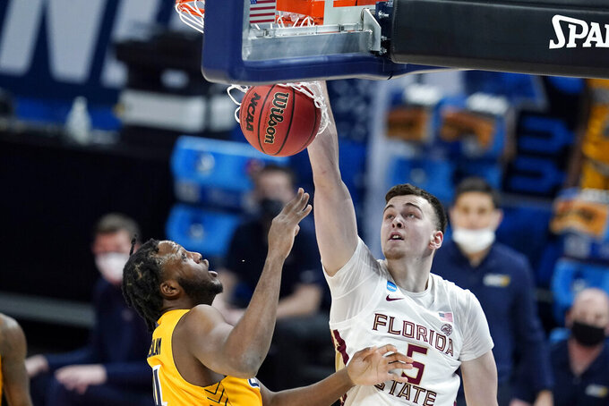 Florida State's Balsa Koprivica (5) dunks against UNC-Greensboro's Mohammed Abdulsalam (4) during the first half of a first-round game in the NCAA men's college basketball tournament at Banker's Life Fieldhouse, Saturday, March 20, 2021, in Indianapolis. (AP Photo/Darron Cummings)