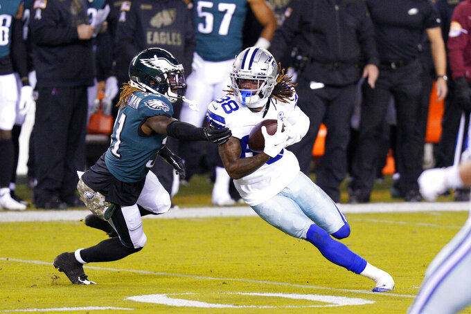 Dallas Cowboys' CeeDee Lamb (88) tries to get past Philadelphia Eagles' Nickell Robey-Coleman (31) during the first half of an NFL football game, Sunday, Nov. 1, 2020, in Philadelphia. (AP Photo/Chris Szagola)