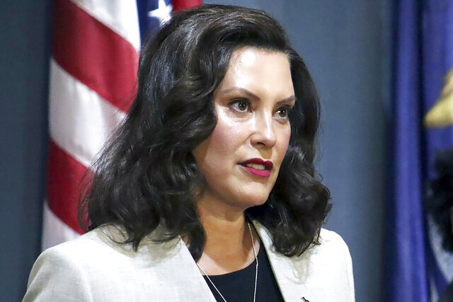 FILE - In a June 17, 2020, file photo provided by the Michigan Office of the Governor, Michigan Gov. Gretchen Whitmer addresses the state during a speech in Lansing, Mich. Whitmer on Tuesday, July 14, 2020, extended Michigan's coronavirus emergency declaration through Aug. 11, citing an uptick in new cases over the past three weeks. The move, which was expected, allows the Democratic governor to keep in place various orders designed to curb COVID-19, including certain business closures, limits on gatherings, a mask requirement and longer unemployment benefits. (Michigan Office of the Governor via AP, File)