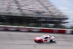 Joe Gibbs (54) moves through Turn 4 during a NASCAR Xfinity Series auto race Saturday, Sept. 5, 2020, in Darlington, S.C. (AP Photo/Chris Carlson)