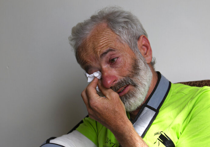 The team leader, Tarcisio Bellò, 57, breaks in tears while talking about his Pakistani colleague who lost his life during heavy avalanche, in Islamabad, Pakistan, Thursday, June 20, 2019.  The renowned Italian mountaineer, who narrowly survived along-with six other members of an expedition on a mountain, recalled how helplessly he saw one of his Pakistani colleagues being swept away by an avalanche that struck them at an altitude of around 5,300 meters (17,390 feet) earlier this week. (AP Photo/B.K. Bangash)