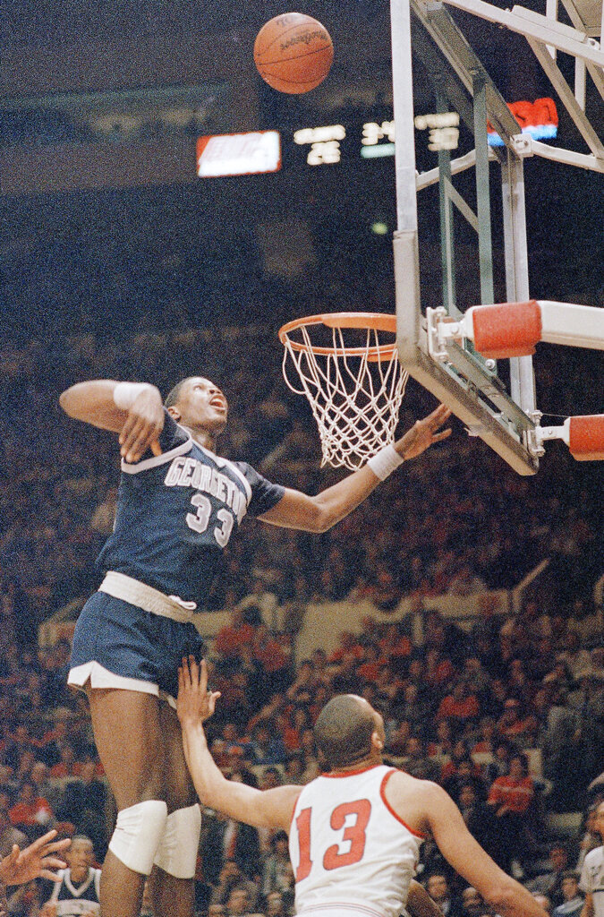 FILE - Georgetown's Patrick Ewing (33) is shown in action during a game against St. John University at New York's Madison Square Garden, in this Feb. 27, 1985, file photo. Georgetown won 85-69. Patrick Ewing and Georgetown are back in the NCAA Tournament. The 7-footer who helped the Hoyas win one national championship and reach two other finals in the 1980s is now coaching at his alma mater. Georgetown is a No. 12 seed and will play No. 5 Colorado in the East Region on Saturday, March 20, 2021. (AP Photo/Ron Frehm, File)