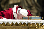 Pope Francis kisses the altar as he celebrates Mass during the Solemnity of Saints Peter and Paul, in St. Peter's Basilica at the Vatican, Monday, June 29, 2020. Francis also blessed the Pallia for the metropolitan archbishops appointed during the year. (Angelo Carconi/Pool Photo via AP)