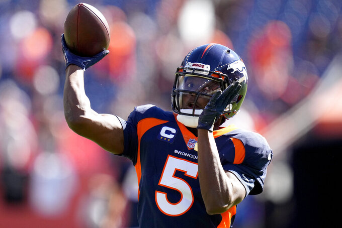 Denver Broncos quarterback Teddy Bridgewater (5) warms up prior to an NFL football game against the Las Vegas Raiders, Sunday, Oct. 17, 2021, in Denver. (AP Photo/Jack Dempsey)