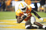 Tennessee's Daniel Bituli (35) rolls to his feet after he recovers a blocked punt in the end zone for a touchdown in an NCAA football game between the University of Tennessee and University of South Carolina played in Knoxville, Tenn., Saturday, Oct. 26, 2019. (Scott Keller/The Daily Times via AP)