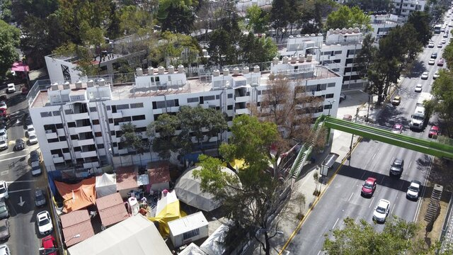 An aerial view of the Multifamiliar Tlalpan in Mexico City, Saturday, Feb 8, 2020. Before the 2017 earthquake, which killed more than 200 people in the capital, the complex was home to 500 families. The residents have trickled back since November as workers finished on one building and then another. (AP Photo/Christian Palma)