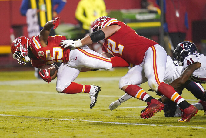 Kansas City Chiefs running back Clyde Edwards-Helaire (25) carries the ball for a first down against the Houston Texans in the second half of an NFL football game Thursday, Sept. 10, 2020, in Kansas City, Mo. (AP Photo/Jeff Roberson)