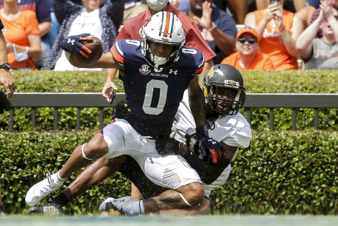 Auburn wide receiver Demetris Robertson (0) catches a pass for a touchdown as Alabama State Keenan Isaac (10) tries to defend during the first half of an NCAA football game Saturday, Sept. 11, 2021, in Auburn, Ala. (AP Photo/Butch Dill)