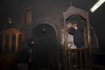 Palestinians visit torched mosque in the Arab neighborhood of Beit Safafa, in east Jerusalem, Friday, Jan. 24, 2020. Israeli police said Friday they are investigating after a