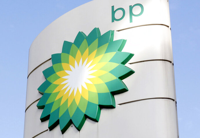 FILE - This Tuesday, Aug. 1, 2017 file photo shows the BP logo at a petrol station in London. Energy company BP is writing off as much as $17.5 billion from its oil and gas assets and will review its plans to develop oil wells as the COVID-19 pandemic accelerates its goal of decreasing its reliance on fossil fuels. (AP Photo/Caroline Spiezio, File)