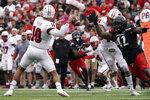 Cincinnati defensive lineman Malik Vann (42) pressures Miami (Ohio) quarterback AJ Mayer (10) during the first half of an NCAA college football game Saturday, Sept. 4, 2021, in Cincinnati. (AP Photo/Jeff Dean)