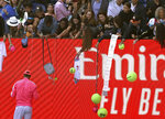 Spain's Rafael Nadal signs autographs after defeating Bolivia's Hugo Dellien in their first round singles match at the Australian Open tennis championship in Melbourne, Australia, Tuesday, Jan. 21, 2020. (AP Photo/Lee Jin-man)
