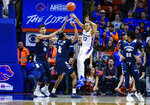 Boise State guard Pat Dembley (13) throws the ball against a Nevada double team during the first half of an NCAA college basketball game, Tuesday, Jan. 15, 2019, in Boise, Idaho. (AP Photo/Steve Conner)