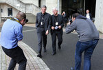 French bishops,Olivier Leborgne, right, and Eric de Moulins Beaufort react as they leave a press conference in Lourdes, southwestern France, Saturday, Nov. 9, 2019. 120 bishops are convening for their biannual assembly in Lourdes, where they will discuss the plan for a
