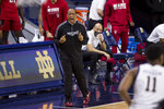 North Carolina State head coach Kevin Keatts yells to his players during the first half of an NCAA college basketball game against Notre Dame on Wednesday, March 3, 2021, in South Bend, Ind. North Carolina State won 80-69. (AP Photo/Robert Franklin)