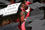 "FILE - In this May 28, 2015, file photo, a graduate student of Harvard Law School displays the message ""Black Lives Matter"" on his mortar board during Harvard University commencement exercises in Cambridge, Mass. Black Lives Matter has gone mainstream — and black activists are carefully assessing how they should respond. (AP Photo/Steven Senne, File)"