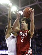 Washington State's CJ Elleby shoots during the second half of the team's NCAA college basketball game against Washington on Friday, Feb. 28, 2020, in Seattle. Washington State won 78-74. (AP Photo/Elaine Thompson)