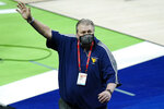 West Virginia head coach Bob Huggins waves to the crowd as he leaves the court following a win over Morehead State in a college basketball game in the first round of the NCAA tournament at Lucas Oil Stadium Saturday, March 20, 2021, in Indianapolis. (AP Photo/Mark Humphrey)