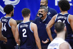 Villanova head coach Jay Wright talks to his players during a timeout in the second half of an NCAA college basketball game against Seton Hall, Saturday, Jan. 30, 2021, in Newark, N.J. (AP Photo/Mary Altaffer)