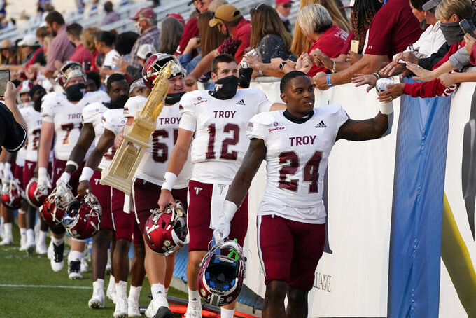 Troy players celebrates with fans after defeating Middle Tennessee in an NCAA college football game Saturday, Sept. 19, 2020, in Murfreesboro, Tenn. Troy won 47-14. (AP Photo/Mark Humphrey)