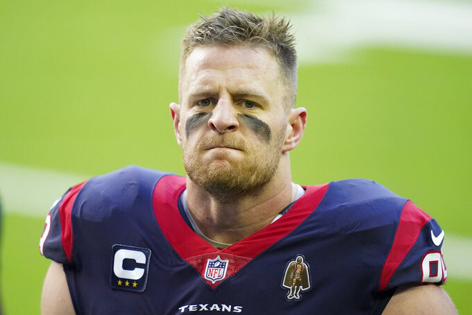 Houston Texans defensive end J.J. Watt (99) is seen during pregame warmups before an NFL football game against the Tennessee Titans, Sunday, Jan. 3, 2021, in Houston. It's too early to know where the NFL salary cap will end up in the range of $180 million to $198 million coming off a pandemic-dominated season that was completed on time but still cost the league billions of dollars in revenue. Although Houston and star defensive end J.J. Watt said his release was a mutual decision, it might have happened regardless with the 32-year-old set to make $15.5 million while the guaranteed money had already been paid in the $100 million, six-year extension he signed in 2014. (AP Photo/Matt Patterson)