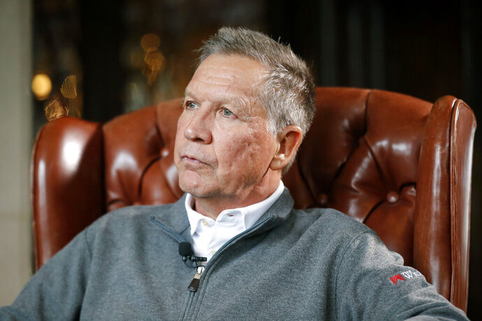 FILE - In a Thursday, Dec. 13, 2018 file photo, Ohio Gov. John Kasich sits for an interview with The Associated Press in Columbus. West Virginia University President Gordon Gee and former Ohio Gov. John Kasich are creating a nonprofit that will fight to steer money from any national opioid settlement to hospitals and health-based research. Gee and Kasich will announce Citizens for Effective Opioid Treatment on Thursday, August 22, 2019. (AP Photo/John Minchillo, File)