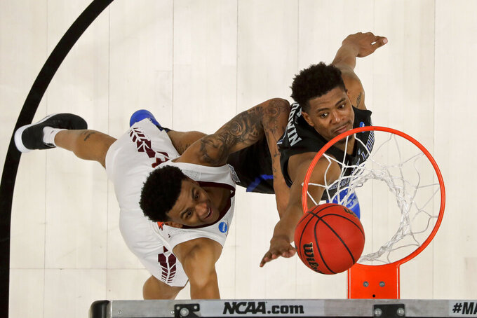 Virginia Tech guard Nickeil Alexander-Walker, left, shoots over Saint Louis guard Jordan Goodwin during the second half of a first-round game in the NCAA men's college basketball tournament Friday, March 22, 2019, in San Jose, Calif. (AP Photo/Ben Margot)