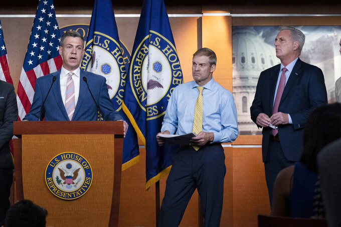 """Rep. Jim Banks, R-Ind., speaks during a news conference as Rep. Jim Jordan, R-Ohio, and House Minority Leader Kevin McCarthy, R-Calif., looks on at Capitol Hill, in Washington, Wednesday, July 21, 2021. Pelosi is rejecting two Republicans tapped by House GOP Leader Kevin McCarthy to sit on a committee investigating the Jan. 6 Capitol insurrection. She cited the """"integrity"""" of the investigation. (AP Photo/Jose Luis Magana)"""