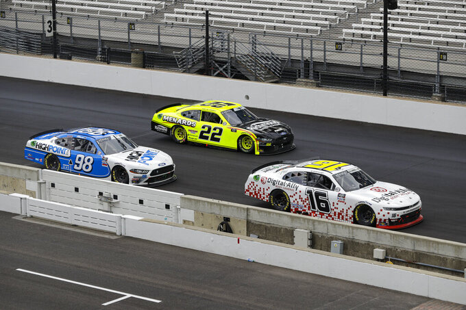 NASCAR Xfinity Series drivers AJ Allmendinger (16), Austin Cindric (22) and Chase Briscoe (98) battle for the lead in the closing laps the NASCAR Xfinity Series auto race at Indianapolis Motor Speedway in Indianapolis, Saturday, July 4, 2020. (AP Photo/Darron Cummings)