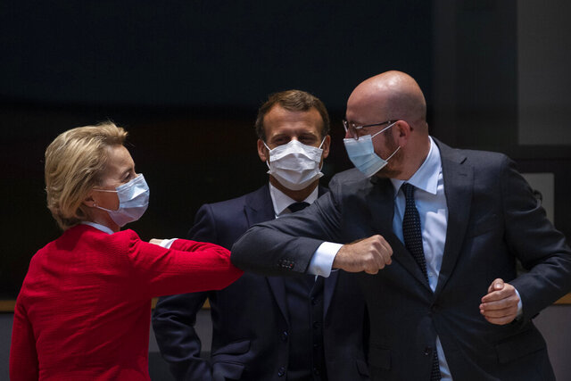 FILE - In this Saturday, July 18, 2020 file photo, European Commission President Ursula von der Leyen, left, greets European Council President Charles Michel with an elbow bump during an EU summit in Brussels. The European Council announced on Tuesday, Sept. 22, 2020 that the European Union summit scheduled to take place on Sept. 24-25, 2020 has been postponed for a week because EU Council President Charles Michel has gone into quarantine as a precaution after a security officer in which he had close contact tested positive for COVID-19. (AP Photo/Francisco Seco, Pool, File)