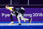 Shani Davis of the U.S., right, and Bart Swings of Belgium, left, compete during the men's 1,500 meters speedskating race at the Gangneung Oval at the 2018 Winter Olympics in Gangneung, South Korea, Tuesday, Feb. 13, 2018. (AP Photo/Vadim Ghirda)