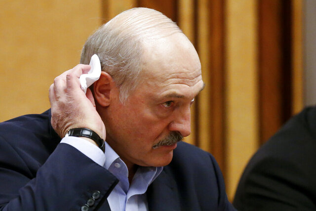 FILE In this file photo taken on Friday, Feb. 7, 2020, Belarusian President Alexander Lukashenko listens to Russian President Vladimir Putin during their meeting in the Black sea resort of Sochi, Russia. Lukashenko faces a perfect storm as he seeks a sixth term in the election held Sunday, Aug. 9, 2020 after 26 years in office. Mounting public discontent over the worsening economy and his government's bungled handling of the coronavirus pandemic has fueled the largest opposition rallies since the Soviet collapse. (AP Photo/Alexander Zemlianichenko, Pool, File)