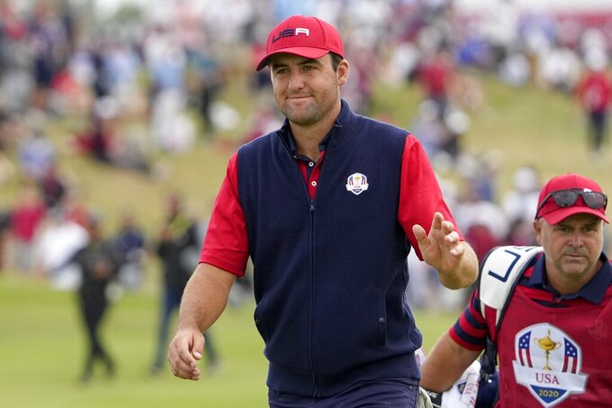 Team USA's Scottie Scheffler walks to the 11th hole during a Ryder Cup singles match at the Whistling Straits Golf Course Sunday, Sept. 26, 2021, in Sheboygan, Wis. (AP Photo/Jeff Roberson)