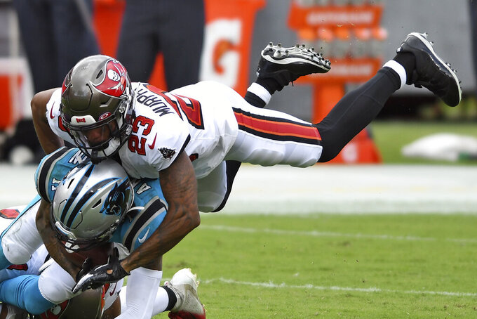 Tampa Bay Buccaneers cornerback Sean Murphy-Bunting (23) takes down Carolina Panthers wide receiver Robby Anderson (11) during the second half of an NFL football game Sunday, Sept. 20, 2020, in Tampa, Fla. (AP Photo/Jason Behnken)