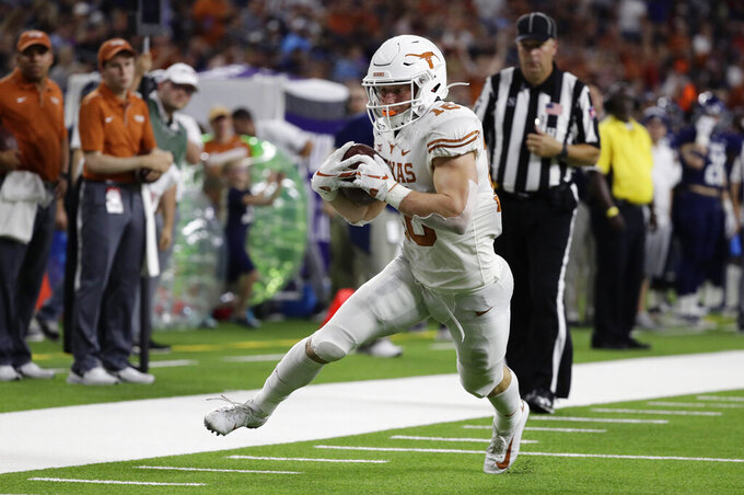 Texas wide receiver Jake Smith (16) scores on a 12-yard reception against Rice during the first half of an NCAA college football game Saturday, Sept. 14, 2019, in Houston. (AP Photo/Eric Gay)
