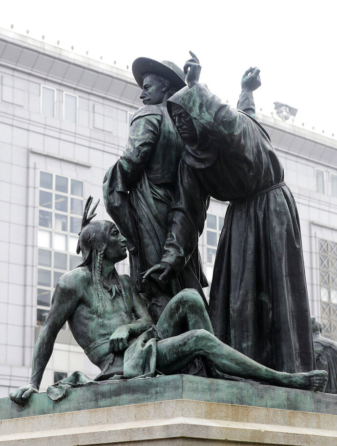 FILE - This March 2, 2018 file photo shows a statue that depicts a Native American at the feet of a Spanish cowboy and Catholic missionary in San Francisco. Activists urging the removal of the prominent 19th century statue will get another chance to make their case. The San Francisco Chronicle reports the city's Board of Appeals voted Wednesday, June 13 to grant a rehearing on removing the