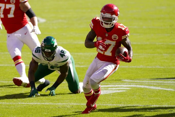 Kansas City Chiefs wide receiver Mecole Hardman (17) gets past New York Jets linebacker Neville Hewitt (46) after catching a pass to score a touchdown in the first half of an NFL football game on Sunday, Nov. 1, 2020, in Kansas City, Mo. (AP Photo/Charlie Riedel)